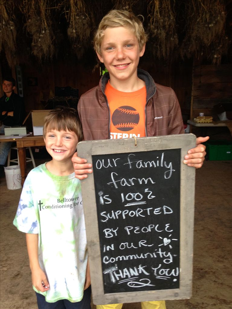 Jacob & Isaiah with a Thank You Sign to all of our farm friends.
